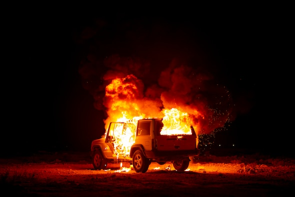 A vehicle burns during a firefighting training exercise August 10, 2021, at Al Udeid Air Base, Qatar.