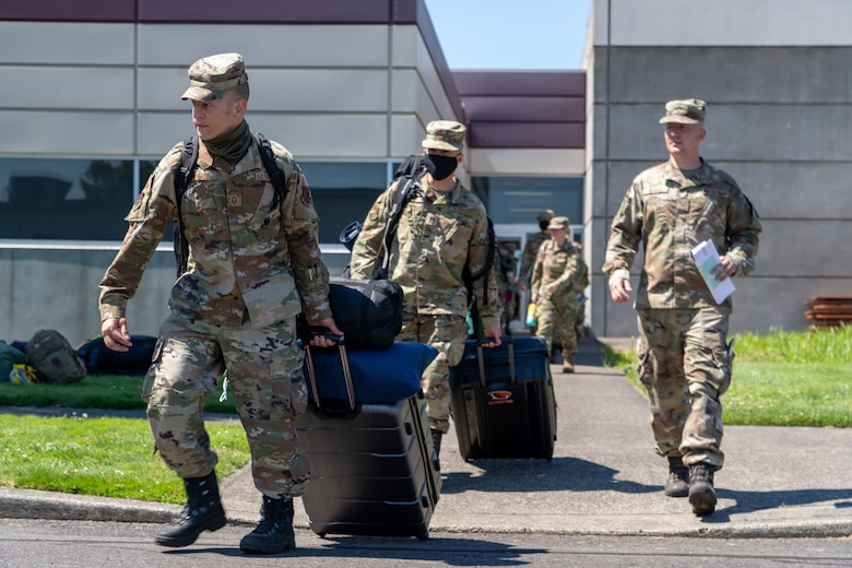 Senior Master Sgt. Joshua Pousson, 142nd Maintenance Group, leads a group of Oregon National Guard Airmen departing Portland Air National Guard Base in support of OPLAN Smokey. OPLAN Smokey requires Airmen to be ready at a moment's notice to help with statewide wildfire relief efforts.