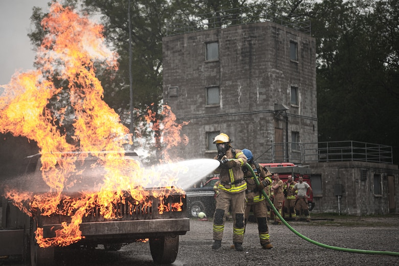 Latvian and Estonian firefighters train on a simulated car fire during Northern Strike 21-2 at the Alpena Combat Readiness Training Center, Michigan, Aug. 6, 2021. Northern Strike is an opportunity to build readiness and interoperability with other units and multinational partners while training in realistic multi-domain environments.