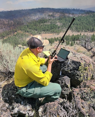 Master Sgt. Brent Hill, Pennsylvania Air National Guard, controls the infrared imagery on an RC26 in support of burn operations on the Beckwourth Fire in California from western Nevada July 13, 2021. Hill is part of a team of imagery experts providing live aerial video streaming to fire bosses working on the front lines of the California wildfires.