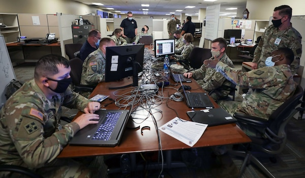 Augmentees from various Army commands collaborate in the joint operations center at Joint Task Force Civil Support headquarters