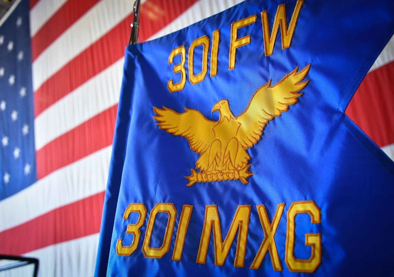 This 301 FW Maintenance Group guideon was given to Col. John Nemecek, the incoming 301 FW MXG commander, August 8, 2021, during at change of command ceremony at U.S. Naval Air Station Joint Reserve Base Fort Worth, Texas. This military tradition symbolizes the transfer of unchallenged authority passed to the new commander to lead their unit. (U.S. Air Force photo by Master Sgt. Jeremy Roman)