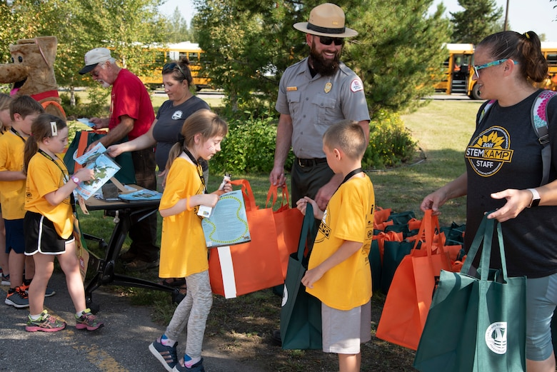 Justin Kerwin, senior park ranger with the U.S. Army Corps of Engineers – Alaska District, welcomes students on Aug. 5 to the Chena River Lakes Flood Control Project near North Pole, Alaska.