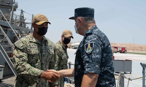 210812-N-WQ732-1016 BERENICE, Egypt (August 12, 2021) – Capt. Joseph Baggett, commanding officer of guided-missile cruiser USS Monterey (CG 61), left, greets Vice Adm. Ahmed Khaled Hassan Saeed, commander of the Egyptian Naval Force, during a tour of the ship in Berenice, Egypt, Aug. 12. Monterey is deployed to the U.S. 5th Fleet area of operations in support of naval operations to ensure maritime stability and security in the Central Region, connecting the Mediterranean and Pacific through the western Indian Ocean and three strategic choke points. (U.S. Navy photo by Mass Communication Specialist Seaman Chelsea Palmer)