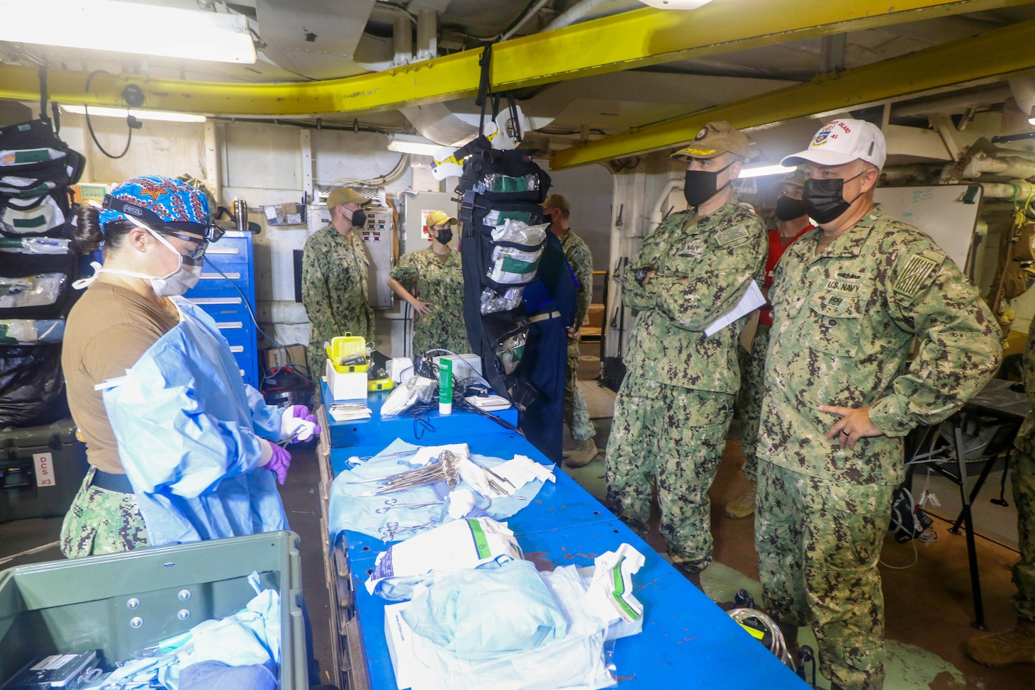 NAVAL STATION NORFOLK (Aug. 14, 2021) – Rear Adm. Darin Via, commander, Naval Medical Forces Atlantic, right, observes members of Fleet Surgical Team 4 in the operating room aboard the dock landing ship USS Whidbey Island (LSD 41), the lead ship of its class of the same name, during a mass casualty drill in support of Large Scale Exercise (LSE) 2021. LSE 2021 demonstrates the Navy's ability to employ precise, lethal, and overwhelming force globally across three naval component commands, five numbered fleets, and 17 time zones. (U.S. Navy photo by Ens. Drew Hendricks)