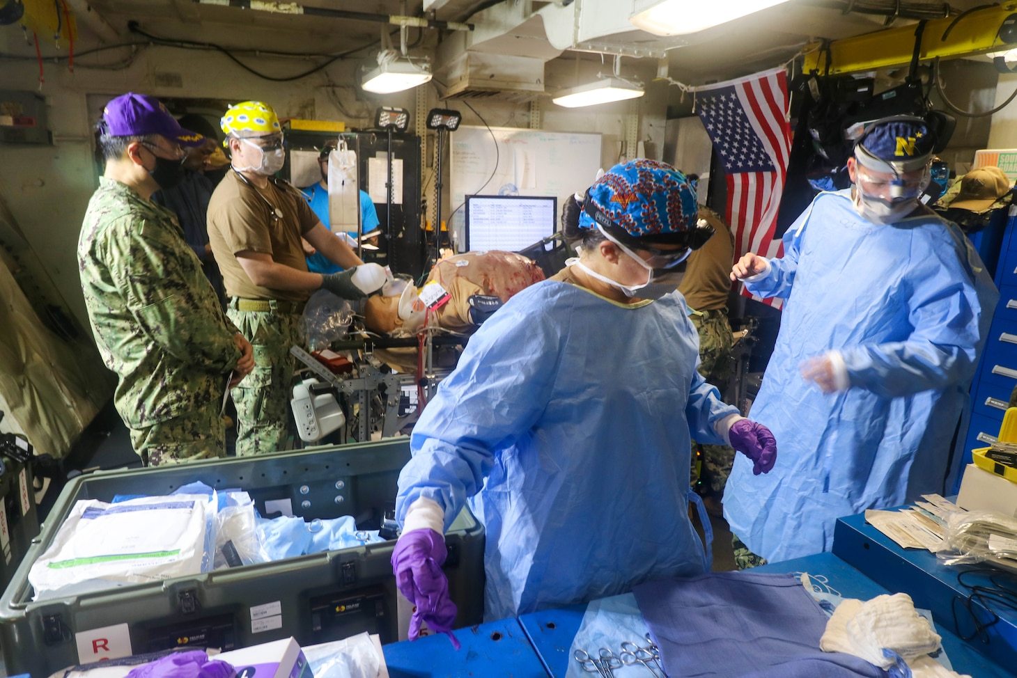 NAVAL STATION NORFOLK (Aug. 14, 2021) –Members of Fleet Surgical Team 4 begin surgery on a simulated crash victim during a mass casualty drill aboard the dock landing ship USS Whidbey Island (LSD 41), the lead ship of its class of the same name, in support of Large Scale Exercise (LSE) 2021. LSE 2021 demonstrates the Navy's ability to employ precise, lethal, and overwhelming force globally across three naval component commands, five numbered fleets, and 17 time zones. (U.S. Navy photo by Ens. Drew Hendricks)