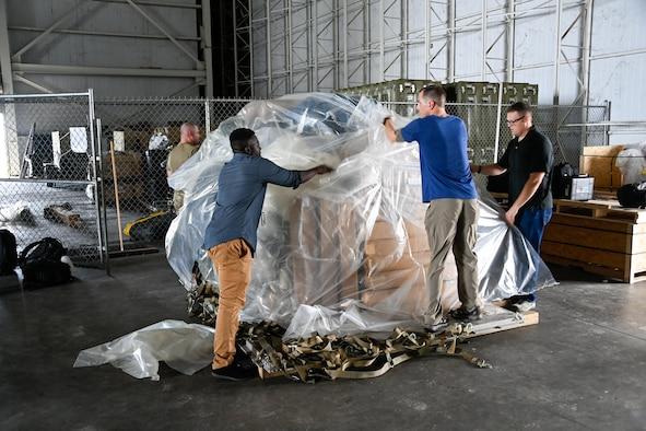 Image of people preparing supplies.
