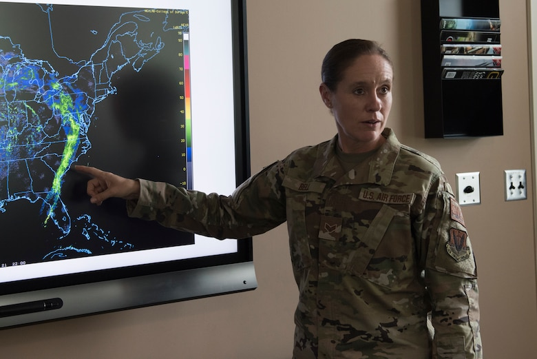 U.S. Air Force Senior Airman Ruth-Ann Bell, a weather forecaster from the 203rd Weather Flight, 193rd Special Operations Wing, Pennsylvania National Guard, presents a weather forecast August 6, 2021 at Fort Indiantown Gap, Annville, Pennsylvania. Bell was chosen as the ANG's Outstanding Airman of the Year 2020. (U.S. Air National Guard photo by MSgt Matt Schwartz)