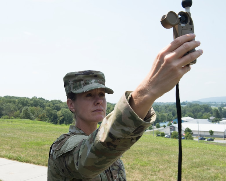U.S. Air Force Senior Airman Ruth-Ann Bell, a weather forecaster from the 203rd Weather Flight, 193rd Special Operations Wing, Pennsylvania Air National Guard uses her Kestrel Heat Stress Tracker August 6, 2021 at Fort Indiantown Gap, Annville, Pennsylvania. Bell was chosen as the ANG's Outstanding Airman of the Year 2020. (U.S. Air National Guard photo by MSgt Matt Schwartz)