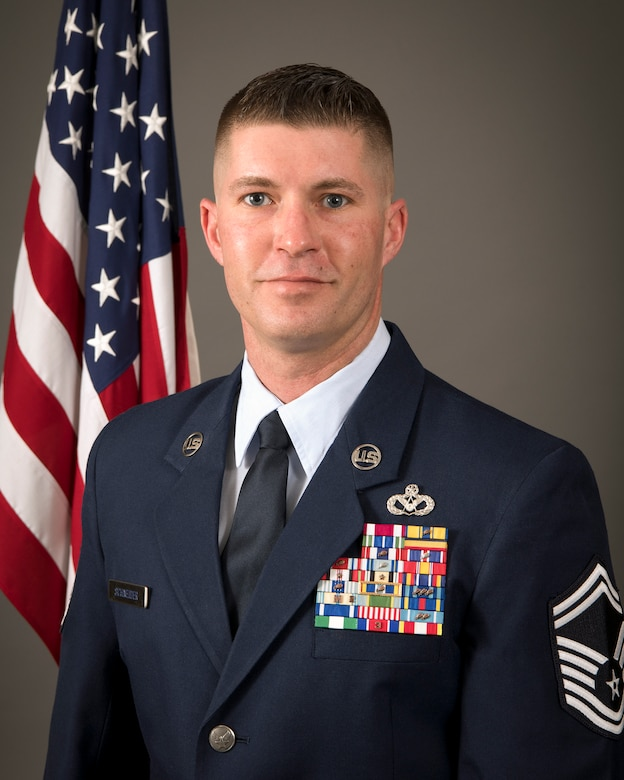 U.S. Air Force Senior Master Sgt. Mark Schneider II, right, 200th RED HORSE, Ohio National Guard, poses for an official portrait at Mansfield Air National Guard Base, Ohio, March 4, 2021. Schneider was named the Air National Guard's Non-Commissioned Officer of the Year. (U.S. Air National Guard photo by Master Sgt. Joseph Harwood)