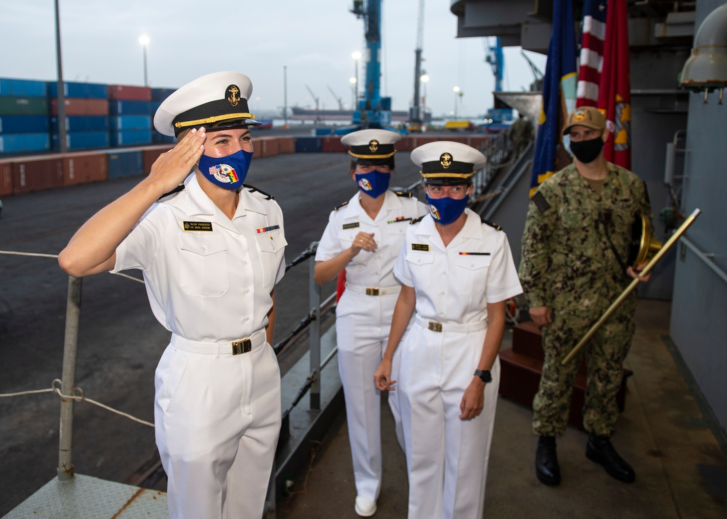 """Midn. Taylor Forrester, left, salutes the commanding officer of the Expeditionary Sea Base Hershel """"Woody"""" Williams (ESB 4) before departing the ship, Aug. 13, 2021."""