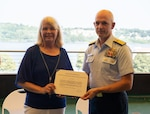 Professor Janet McLeavey at her retirement ceremony, Aug. 11, 2021. McLeavey became the first female faculty member to be employed by the Coast Guard Academy in 1974 and subsequently served for 37 years. (U.S. Coast Guard photo by Petty Officer 3rd Class Matthew Abban).