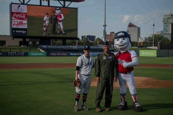 Col. Nate Vogel, 22nd Air Refueling Wing commander (center), poses for a photo with Max Puls, Lonestar Baseball Club first baseman (left), and the National Baseball Congress World Series mascot before the ball game, Aug. 19, 2021, in Wichita, Kansas. The NBC World Series held their annual tournament in Kansas, and finished with championship week at Riverfront Stadium in Wichita, Kansas. (U.S. Air Force photo by Senior Airman Marc A. Garcia)