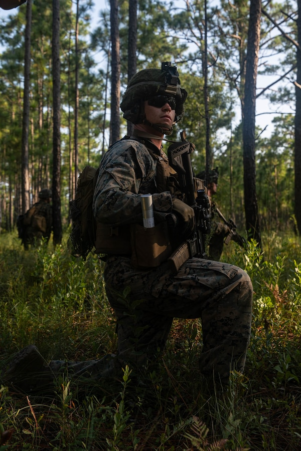 U.S. Marine Corps Cpl. William Collins, a squad leader with 3d Battalion, 2d Marine Regiment, 2d Marine Division, waits to provide support on a support-by-fire range during a field exercise on Camp Lejeune, N.C., Aug. 12, 2021.
