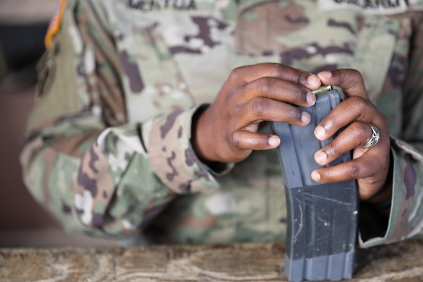 An Army Reserve Soldier assigned to Headquarters and Headquarters Detachment, 84th Training Command, loads a rifle magazine with ammunition during rifle marksmanship qualification held Aug. 7, 2021, at Camby Hill Range in Fort Knox, Kentucky. (U.S. Army photo by Sgt. 1st Class Osvaldo P. Sanchez)