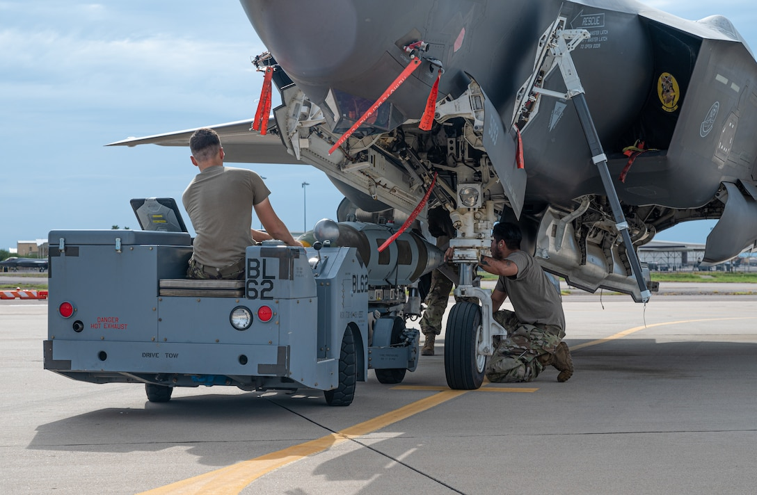 U.S. Air Force maintainers from the 61st Aircraft Maintenance Unit load a GBU-31 joint direct attack munition on an F-35A Lightning II Aug. 9, 2021, at Luke Air Force Base, Arizona.