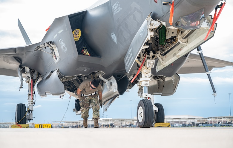 U.S. Air Force Airman 1st Class Justin Williams, 61st Aircraft Maintenance Unit maintainer, finishes loading a GBU-31 joint direct attack munition on an F-35A Lightning II Aug. 9, 2021, at Luke Air Force Base, Arizona.