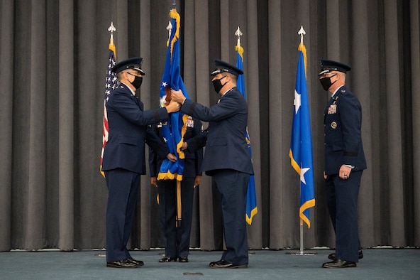 Maj. Gen. Andrew Gebara, center, incoming 8th Air Force and Joint-Global Strike Operations Center commander, receives the guidon from Gen. Tim Ray, commander of Air Force Global Strike Command, during a change of command ceremony at Barksdale Air Force Base, La., August 16, 2021. The passing of a unit's guidon symbolizes a transfer of command. (U.S. Air Force photo by  Senior Airman Jovante Johnson)