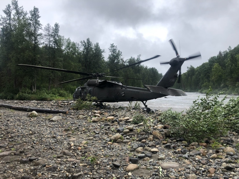 An Alaska Army National Guard UH-60L Black Hawk medevac helicopter from Detachment 2, G Company, 2nd Battalion, 211th Aviation Regiment, sits on a gravel sandbar at the headwater of the Yentna River, Alaska, about 70 miles northwest of Anchorage in a remote area that may only be accessed by aircraft or boat. Medevac aircrew from the AKNG provided emergency medical assistance and helicopter medical evacuation to a 75-year old man after he fell into a river and drowned, requiring immediate resuscitation and sustaining multiple injuries, Aug. 12, 2021.(Courtesy photo by U.S. Army National Guard crew chief, Staff Sgt. Bradley McKenzie)