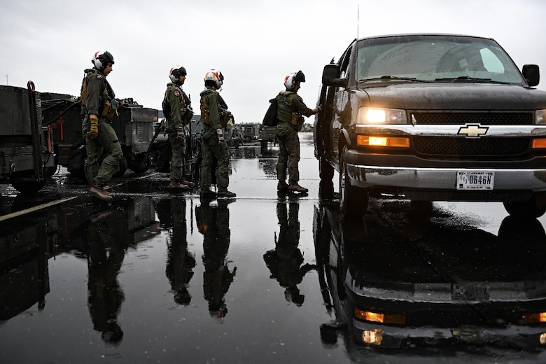 U.S. Air Force F-35A Lightning II pilots enter a van to be transported to the flight line at Eielson Air Force Base, Alaska, Aug. 16, 2021. The Aug. 12 – 27 iteration of the base's Red Flag exercise placed a focus on fifth-generation aircraft training, including air combat simulations. (U.S. Air Force photo by Staff Sgt. Christian Conrad)