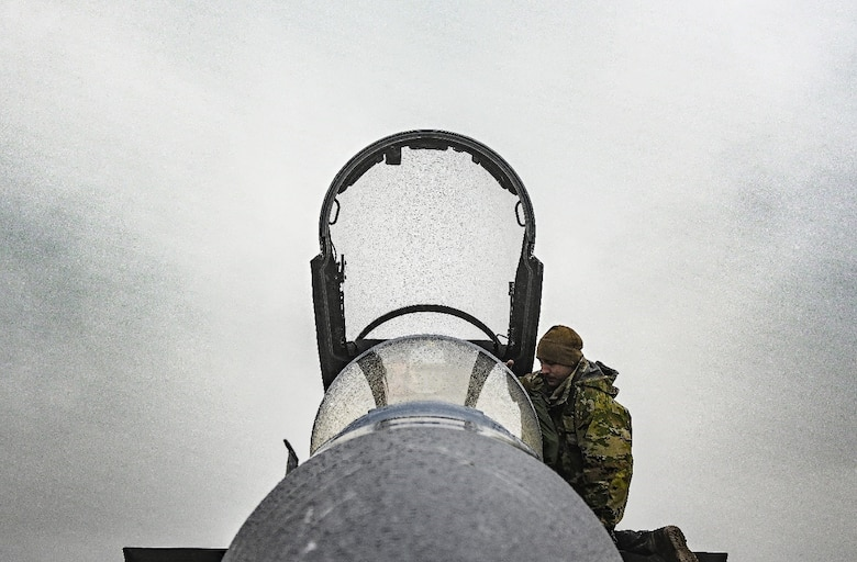 An Airman assigned to the 18th Aircraft Maintenance Squadron performs pre-flight checks on an F-35A Lightning II ahead of a flying mission Aug. 16, 2021, at Eielson Air Force Base, Alaska. The flying mission was part of a Red Flag exercise designed to test air combat tactics on fifth-generation aircraft. (U.S. Air Force photo by Staff Sgt. Christian Conrad)