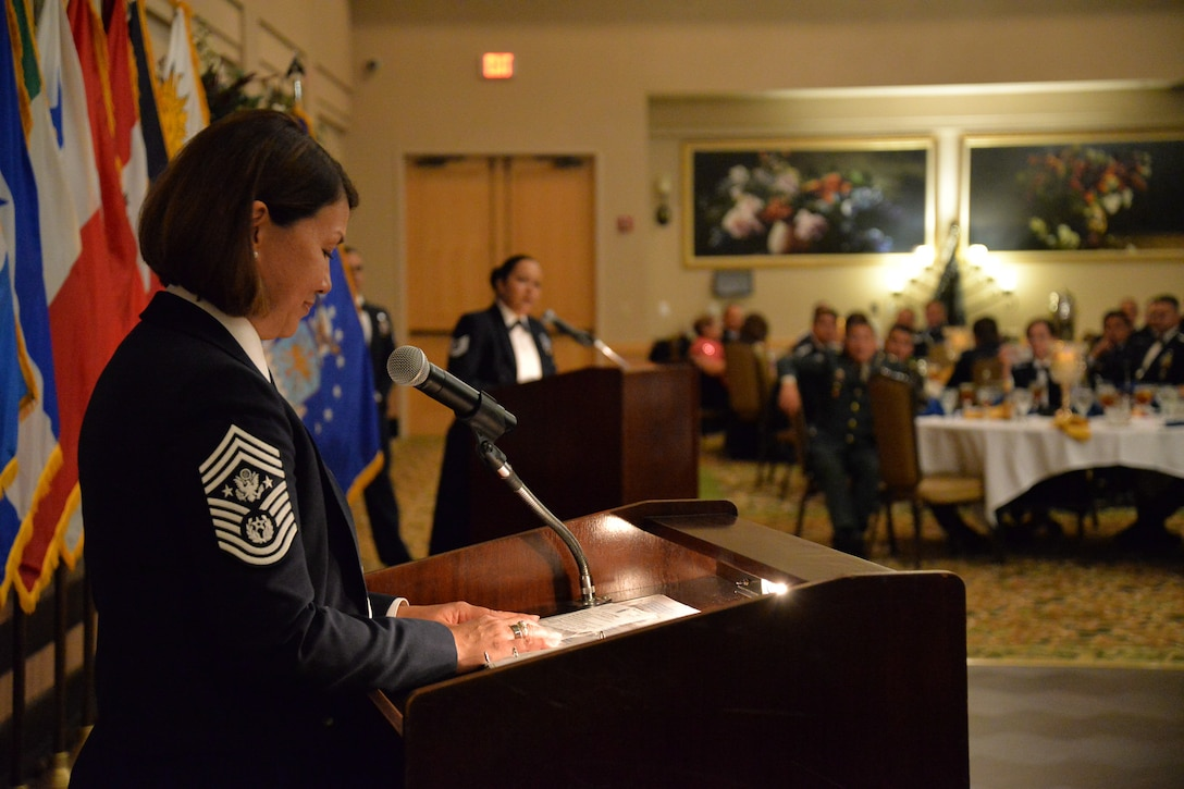 CMSAF stands at podium while NCO translates.