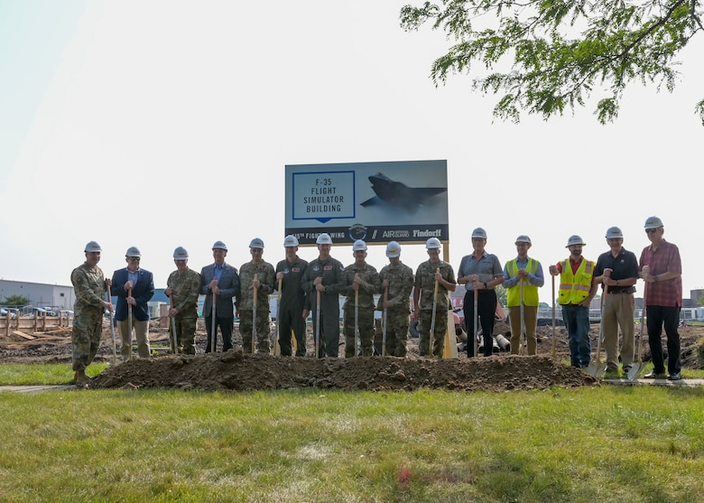Leadership personnel from the Wisconsin Air National Guard and local organizations prepare to break ground Aug. 11, 2021 for the 115th Fighter Wing's first major project leading up to the beddown of the F-35 Lightning II at Truax Field. The ceremony brought together military and civilian leadership to commemorate the future of the Madison unit as the selected beddown site of the F-35 Lightning II aircraft. (U.S. Air National Guard photo by Staff Sgt. Cameron Lewis)