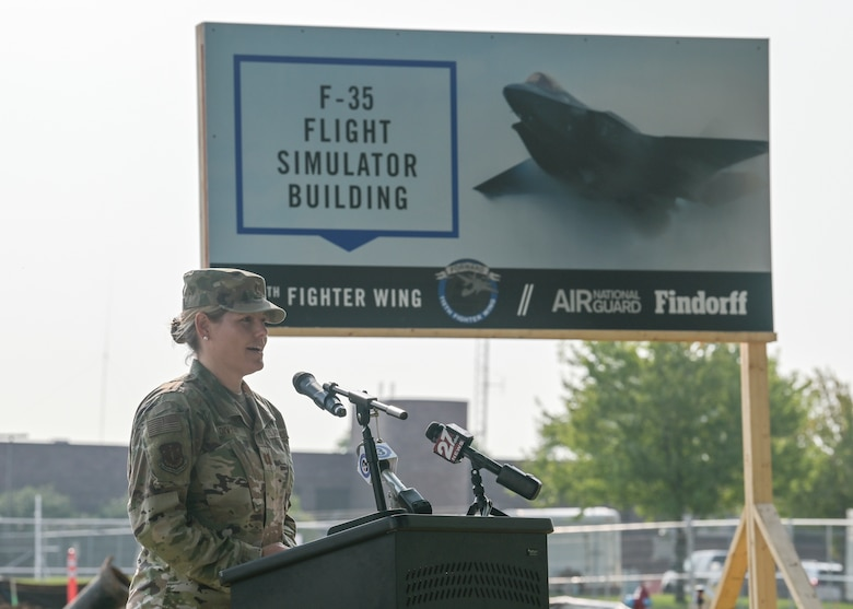U.S. Air Force Capt. Katie Divyak, the wing executive officer assigned to the 115th Fighter Wing, Truax Field, Madison, Wisconsin, presents a breaking ground ceremony for the 115th Fighter Wings first F-35 Lightning II conversion project. Aug. 11, 2021.  The ceremony brought together military and civilian leadership to commemorate the future of the Madison unit as the selected beddown site of the F-35 Lightning II aircraft. (U.S. Air National Guard photo by Staff Sgt. Cameron Lewis)