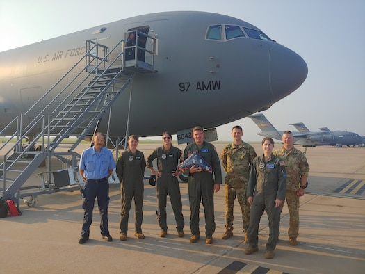 KC-46 Pegasus aircrew in front of a KC-46 with a flag at Altus Air Force Base, Oklahoma, Aug. 3, 2021.