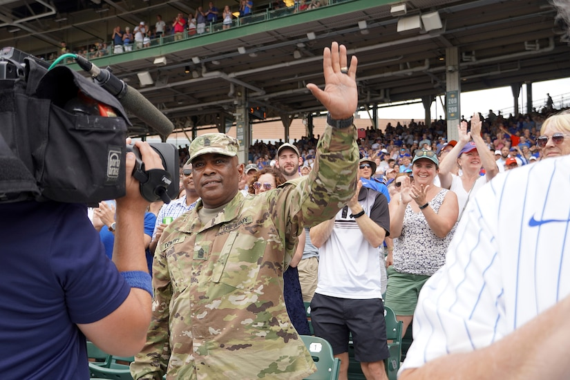 U.S. Army Reserve Command Sgt. Maj Theodore Dewitt is honored for his service during a Chicago Cubs home game, at Wrigley Field in Chicago, August 12, 2021.