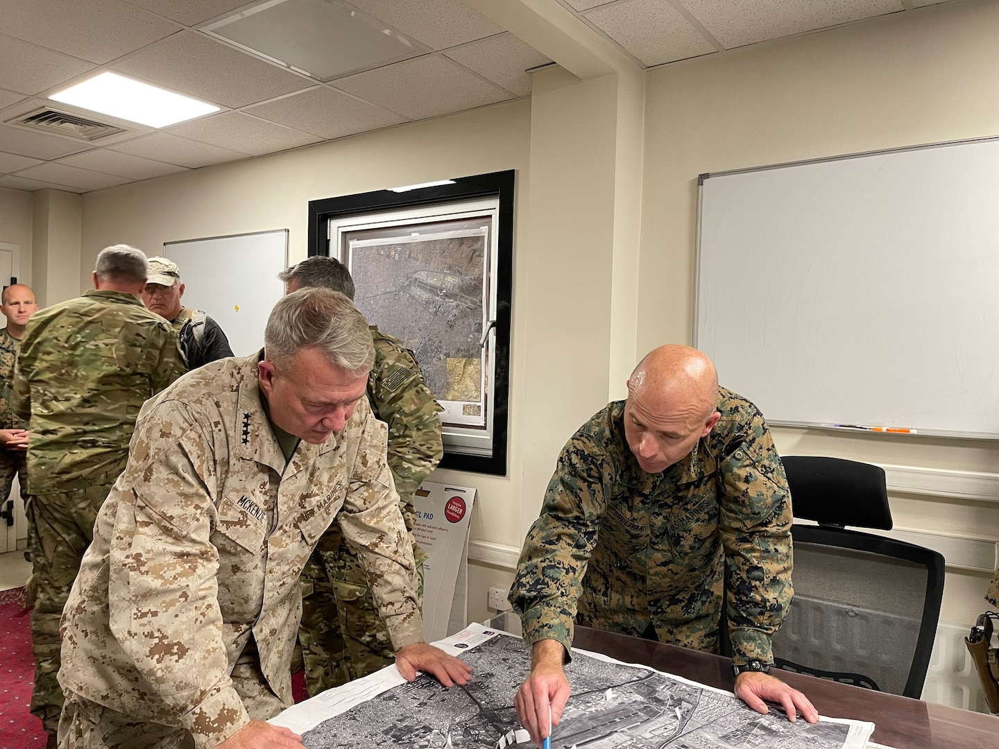 U.S. Marine Corps Gen. Frank McKenzie, the commander of U.S. Central Command, directs operations with U.S. Marine Corps Brig. Gen. Farrell J. Sullivan, the commander of the Naval Amphibious Task Force 51/5th Marine Expeditionary Brigade, at Hamid Karzai International Airport, Afghanistan on August 17, 2021. (U.S. Navy photo by Capt. William Urban)