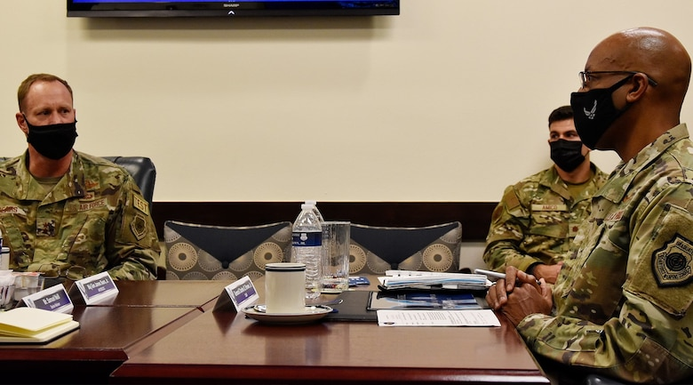 Maj. Gen. James Sears, Air Force Operational Test and Evaluation Center commander, briefs Air Force Chief of Staff Gen. CQ Brown, Jr., about how AFOTEC is meeting the challenge of accelerating change through the test enterprise during CSAF's visit to the center at Kirtland Air Force Base, N.M., Aug. 12, 2021.