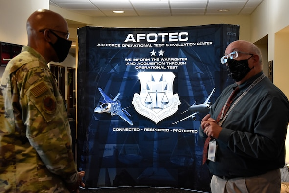 Air Force Chief of Staff Gen. CQ Brown, Jr., talks with Russ Foos, Air Force Operational Test and Evaluation Center training chief, before visiting students at the AFOTEC 301 operational test course that teaches students how to plan, execute, and report operational testing throughout the acquisition of combat capability.