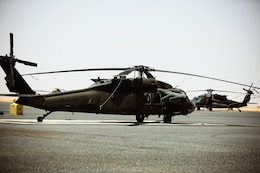 A UH-60 Blackhawk helicopter sits on the flight line at Camp Buehring, Kuwait, July 26, 2021. Nineteen Soldiers assigned to the 82nd Combat Aviation Brigade deployed to Kuwait to provide direct support to the 1100th Theater Aviation Support Maintenance Group and help alleviate a shortage of aviation contractors due to the COVID-19 pandemic. (U.S. Army photo by Sgt. Jimmie Baker)
