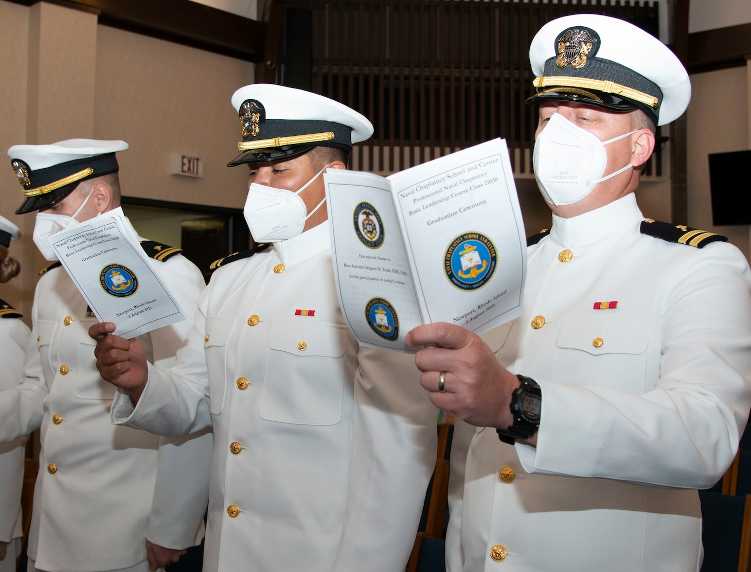"""Students assigned to the Naval Chaplaincy School and Center, on Naval Station Newport, R.I., in the Basic Leadership Course, class 21030, sing """"Anchors Aweigh"""" during their graduation ceremony at the Chapel of Hope, Aug. 4. The Basic Leadership Course is a seven-week course which teaches basic knowledge of military chaplaincy as well as the fundamental skills to enable them to function effectively in a variety of sea service venues. (U.S. Navy photo by Mass Communication Specialist 2nd Class Derien C. Luce)"""