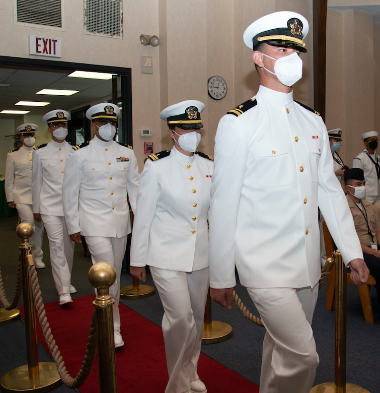 Students assigned to the Naval Chaplaincy School and Center, on Naval Station Newport, R.I., in the Basic Leadership Course, class 21030, march into their graduation ceremony at the Chapel of Hope, Aug. 4. The Basic Leadership Course is a seven-week course which teaches basic knowledge of military chaplaincy as well as the fundamental skills to enable them to function effectively in a variety of sea service venues. (U.S. Navy photo by Mass Communication Specialist 2nd Class Derien C. Luce)