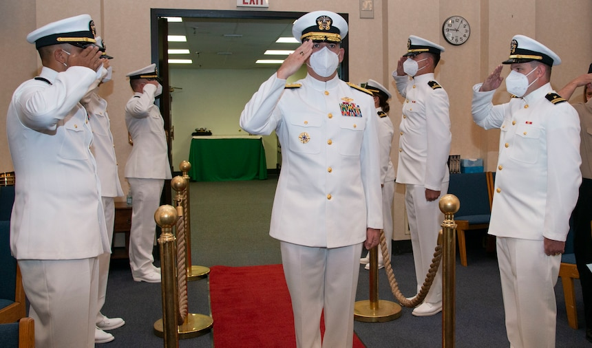NEWPORT, R.I. (Aug. 4, 2021) Rear Adm. Gregory Todd, Chaplain of the Marine Corps and Deputy Chief of Chaplains, passes through side boys while walking into the Chapel of Hope, on Naval Station Newport, R.I., during a graduation ceremony for students assigned to the Naval Chaplaincy School and Center in the Basic Leadership Course, class 21030, Aug. 4. The Basic Leadership Course is a seven-week course which teaches basic knowledge of military chaplaincy as well as the fundamental skills to enable them to function effectively in a variety of sea service venues. (U.S. Navy photo by Mass Communication Specialist 2nd Class Derien C. Luce)