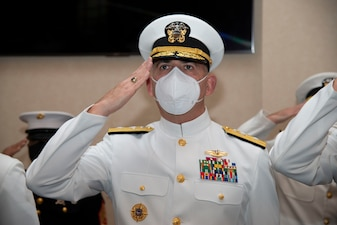 Rear Adm. Gregory Todd, Chaplain of the Marine Corps and Deputy Chief of Chaplains, salutes while the nation anthem plays during a graduation ceremony held in the Chapel of Hope, on Naval Station Newport, R.I., for students assigned to the Naval Chaplaincy School and Center in the Basic Leadership Course, class 21030, Aug. 4. The Basic Leadership Course is a seven-week course which teaches basic knowledge of military chaplaincy as well as the fundamental skills to enable them to function effectively in a variety of sea service venues. (U.S. Navy photo by Mass Communication Specialist 2nd Class Derien C. Luce)