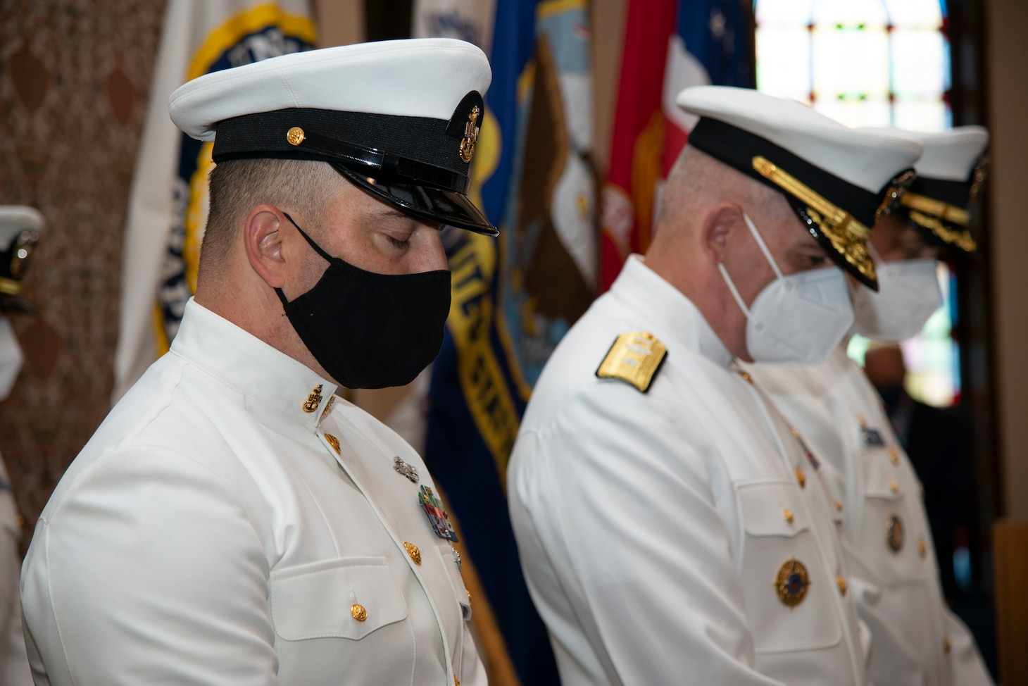 Students assigned to the Naval Chaplaincy School and Center, on Naval Station Newport, R.I., in the Basic Leadership Course, class 21030, lower their heads for the invocation during their graduation ceremony at the Chapel of Hope, Aug. 4. The Basic Leadership Course is a seven-week course which teaches basic knowledge of military chaplaincy as well as the fundamental skills to enable them to function effectively in a variety of sea service venues. (U.S. Navy photo by Mass Communication Specialist 2nd Class Derien C. Luce)