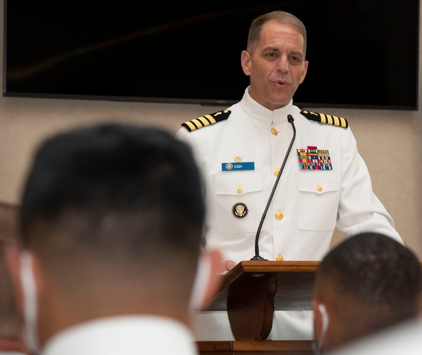 Capt. Carey Cash, commanding officer, Naval Chaplaincy School and Center (NCSC), gives the welcoming remarks during a graduation ceremony held in the Chapel of Hope, on Naval Station Newport, R.I., for students assigned to NCSC in the Basic Leadership Course, class 21030, Aug. 4. The Basic Leadership Course is a seven-week course which teaches basic knowledge of military chaplaincy as well as the fundamental skills to enable them to function effectively in a variety of sea service venues. (U.S. Navy photo by Mass Communication Specialist 2nd Class Derien C. Luce)