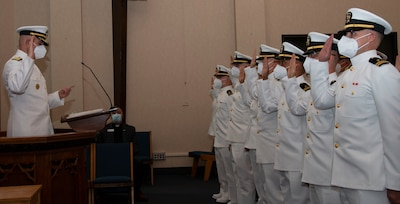 Rear Adm. Gregory Todd, Chaplain of the Marine Corps and Deputy Chief of Chaplains conducts the reaffirmation of commissioning oat during a graduation ceremony held in the Chapel of Hope, on Naval Station Newport, R.I., for students assigned to the Naval Chaplaincy School and Center in the Basic Leadership Course, class 21030, Aug. 4. The Basic Leadership Course is a seven-week course which teaches basic knowledge of military chaplaincy as well as the fundamental skills to enable them to function effectively in a variety of sea service venues. (U.S. Navy photo by Mass Communication Specialist 2nd Class Derien C. Luce)