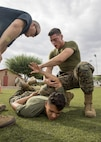 A U.S. Marine with the Provost Marshal Office apprehends a suspect during oleoresin capsicum spray training on Marine Corps Air Station Yuma, Ariz., July 30, 2021. After being sprayed, Marines were required to go through a series of obstacles in order to complete the course. (U.S. Marine Corps photo by Lance Cpl. Matthew Romonoyske-Bean)