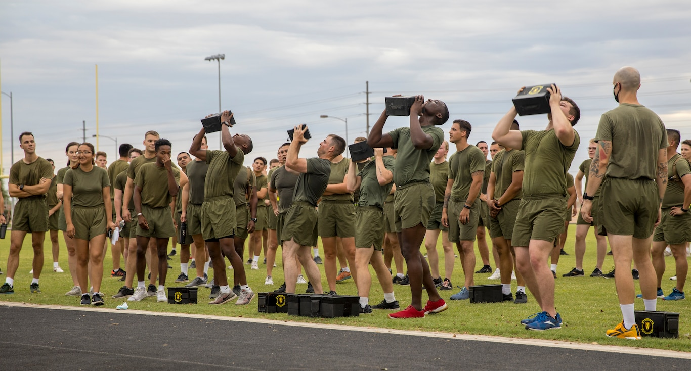 U.S. Marines from Headquarters and Headquarters Squadron (H&HS) participate in a squadron wide physical training (PT) event on Marine Corps Air Station Yuma, Ariz., July 30, 2021. H&HS holds monthly PT events to build comradery among the sections . (U.S. Marine Corps photo by LCpl. Matthew Romonoyske-Bean)