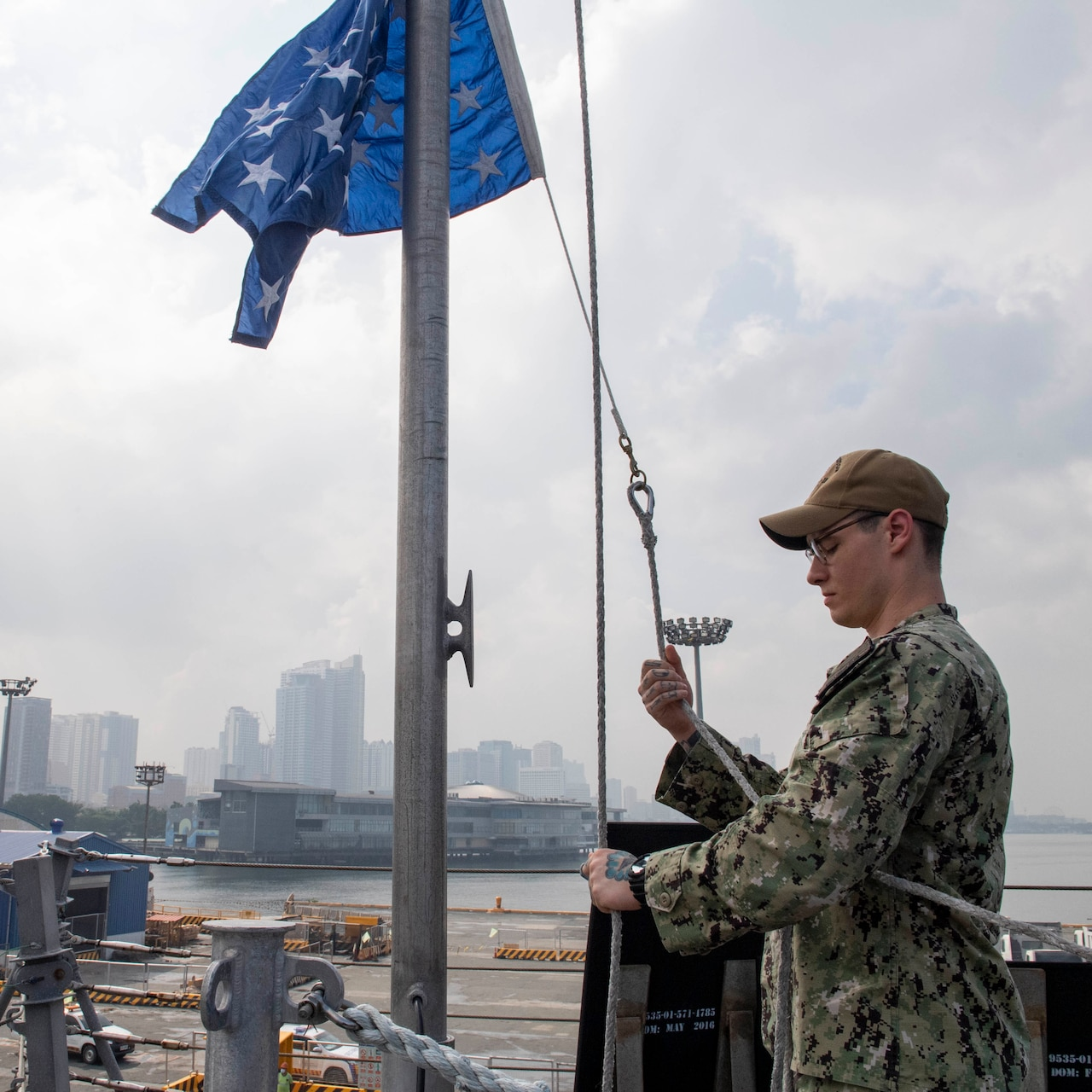Operations Specialist 2nd Class Andrew Weimer, from Dallas, raises a union jack during a sea and anchor detail aboard Independence-variant littoral combat ship USS Charleston (LCS 18), Aug. 16. Charleston, part of Destroyer Squadron Seven, is on a rotational deployment operating in the U.S. 7th Fleet area of operation to enhance interoperability with partners and serve as a ready-response force in support of a free and open Indo-Pacific region.