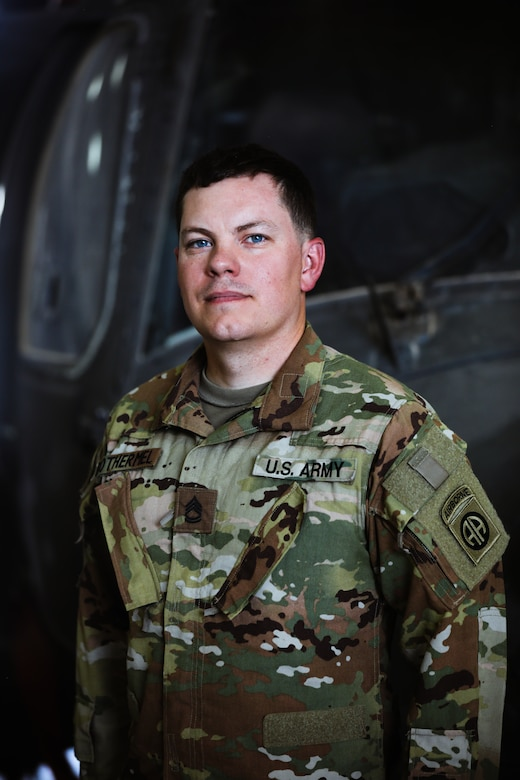 Sgt. 1st Class Carl Rothermel, maintenance noncommissioned officer in charge, 82nd Combat Aviation Brigade, stands in front of a UH-60 Blackhawk helicopter at Camp Buehring, Kuwait, July 26, 2021. Rothermel and 19 Soldiers from the 82nd Combat Aviation Brigade deployed to Kuwait to augment the 1100th Theater Aviation Support Maintenance Group and help alleviate a shortage of aviation contractors due to the COVID-19 pandemic. (U.S. Army photo by Sgt. Jimmie Baker)