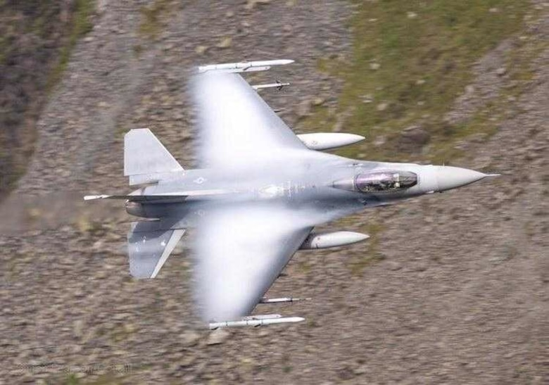 A U.S. Air Force F-16 Fighting Falcon assigned to the 31st Fighter Wing participates in a live fire air-to-air missile training employment event in northwestern Wales, July, 2021. For the first time in 14 years, the 31st FW had the opportunity to conduct F-16C air-to-air live fire training employment within the United States Air Forces in Europe and Air Forces Africa (USAFE) area of responsibility, July 9-16, 2021. (Courtesy photo)