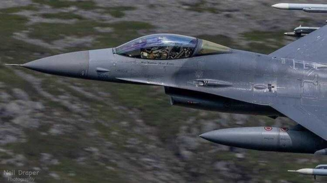 A U.S. Air Force F-16 Fighting Falcon assigned to the 31st Fighter Wing participates in a live fire air-to-air missile training employment event in northwestern Wales, July, 2021. Five F-16s and 36 U.S. Airmen assigned to the 510th Fighter Squadron (FS) and 555th FS conducted live fire air-to-air missile launches with F-15E Strike Eagles from the 494th and 492nd Fighter Squadrons assigned to Royal Air Force (RAF) Lakenheath, England. The training was in coordination with the Aberporth Range Complex in northwestern Wales. (Courtesy Photo)