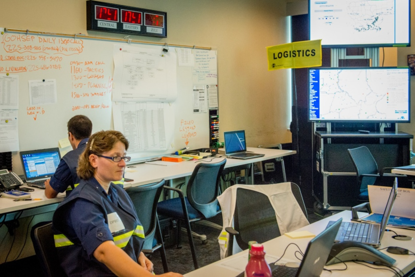 Coast Guard Sector New Orleans command center personnel work to respond to calls from the Baton Rouge flooding in New Orleans, August 17, 2016. The Coast Guard actively coordinated search and rescue cases for people in distress.