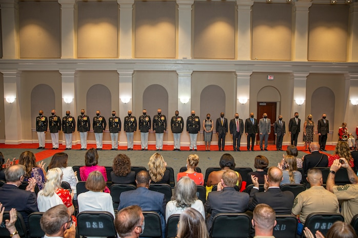 Honorees stand at the position of attention for honors during the Brigadier General Select Orientation Course Honors Ceremony at Marine Barracks Washington, Aug. 16, 2021.