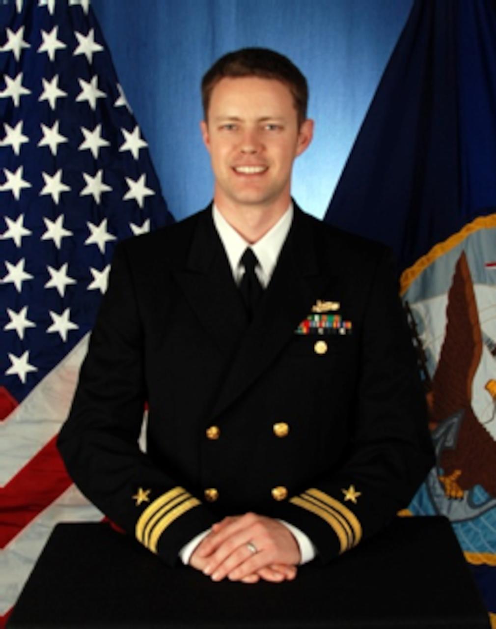 Studio portrait of Lt. Cmdr. David M. Schaller